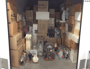 Abandoned storage unit containing collectible figurines of celebrities and dolls