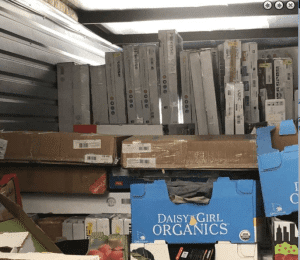 10x45 online storage unit filled with flat screen TVs and other merchandise